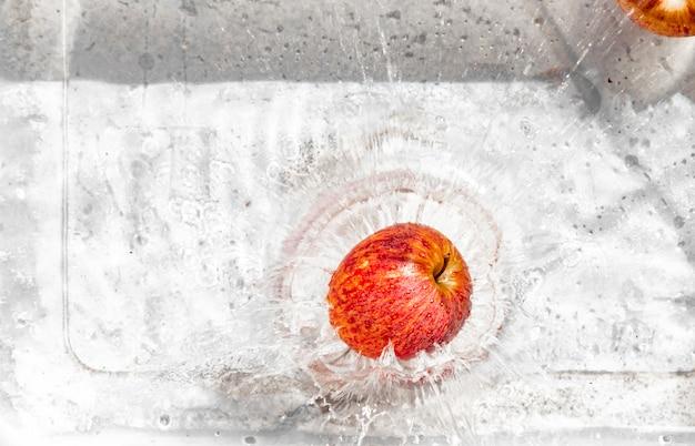 Apple splashes in water