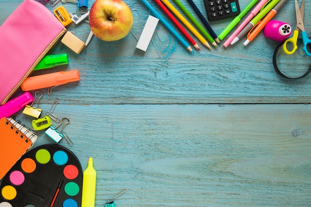 Apple and stationery on tabletop