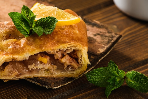 Apple strudel cake with mint and lemon.