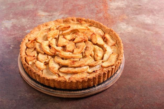 Apple tart served on stone table