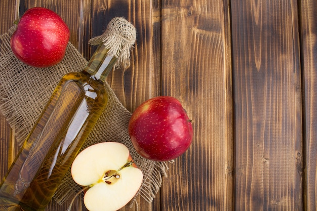Apple vinegar cider in the glass bottle