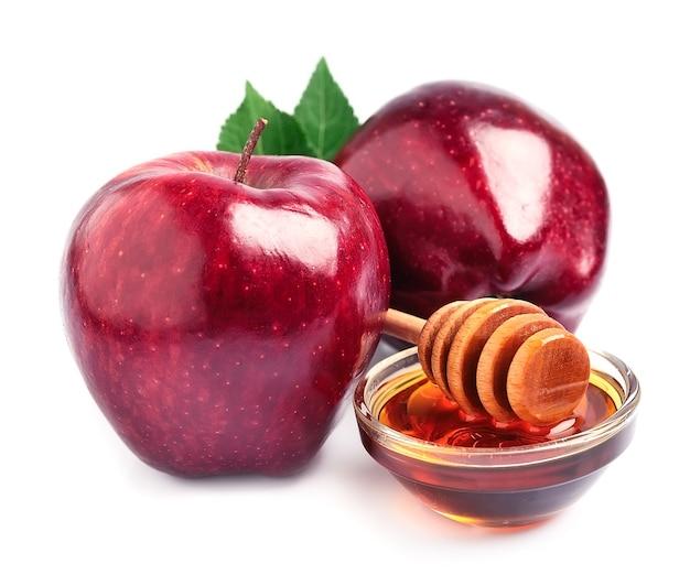 白に分離された蜂蜜とリンゴ
