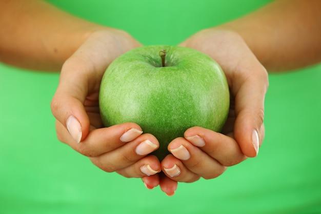 Apple in woman hands