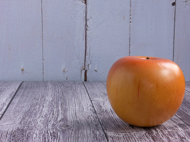 The apple on wood table for food or health concept