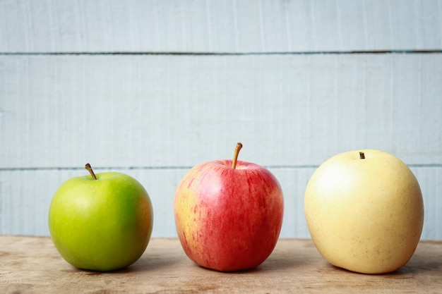 Apples against the wall in home
