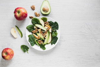 Apples and avocado near salad