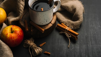 Apples and thread near cloth and spiced drink