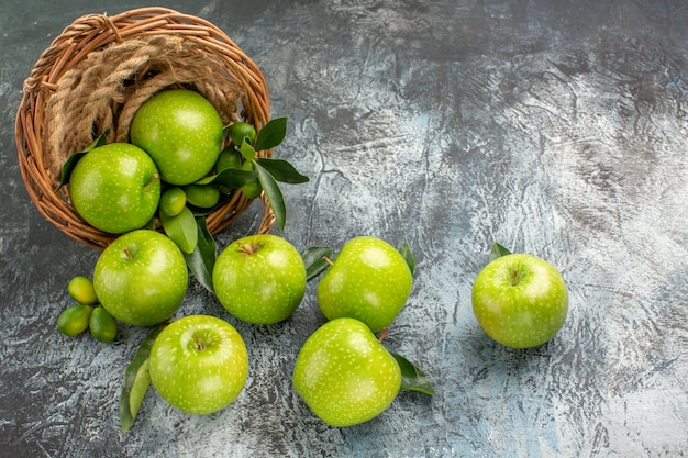 Apples the appetizing green apples in the basket rope