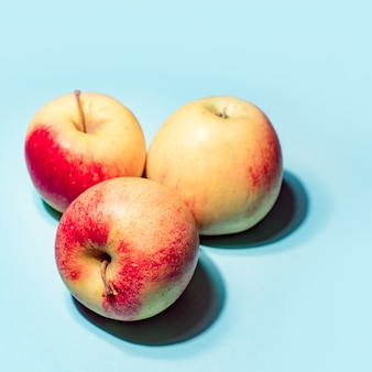 Apples on blue background art image.