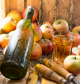 Apples and a bottle and glass of cider