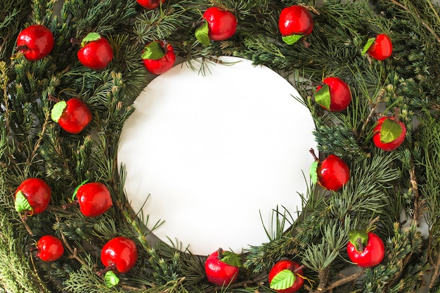 Apples on conifer wreath