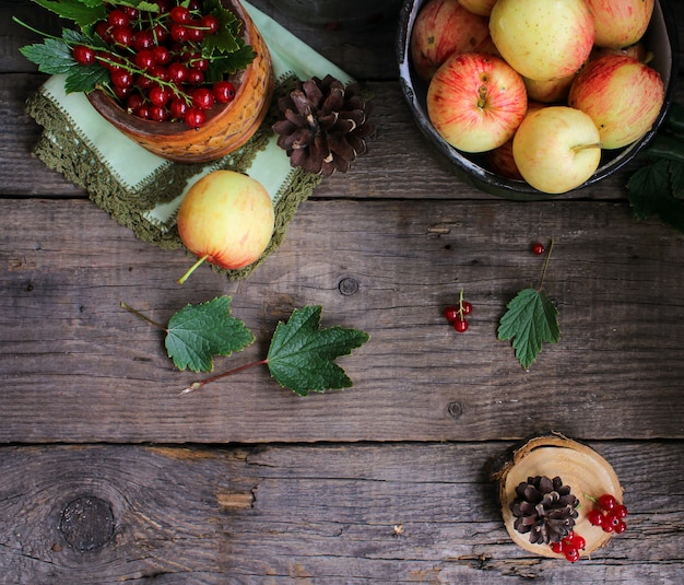 Apples currant wooden background
