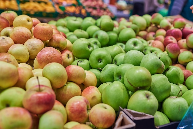 Apples green and red in the store