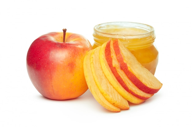 Apples and honey jar for jewish new year holiday isolated on white