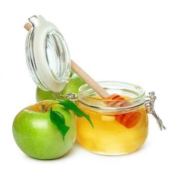 Apples and honey jar for jewish new year holiday isolated