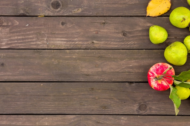 Apples and pears on a wooden background with copy space