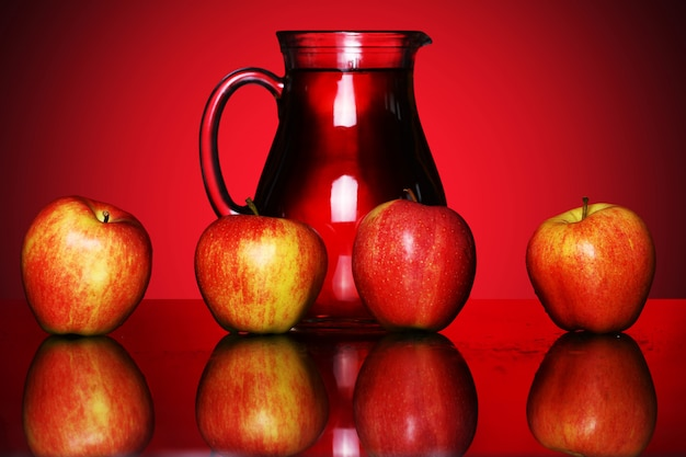 Apples and pitcher with juice
