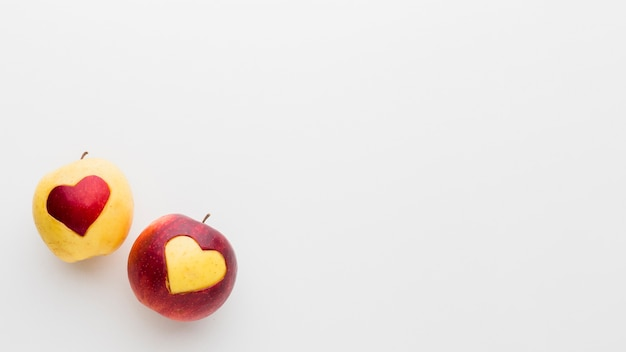 Apples with fruit heart shapes and copy space