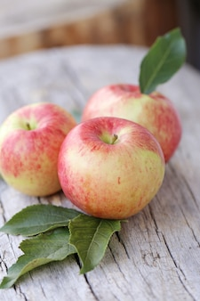 Apples on a wooden surface