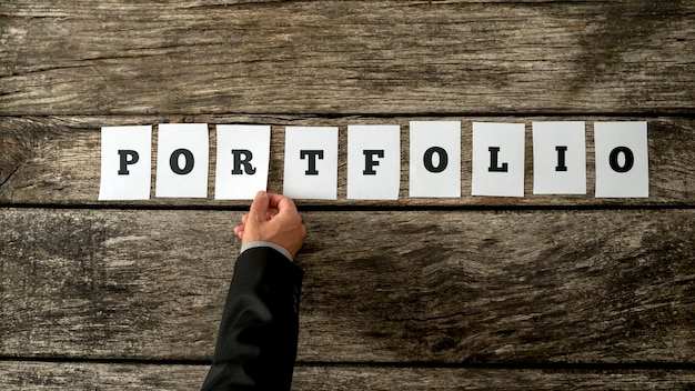 Applicant for a job opportunity or businessman with many financial assets assembling a word portfolio
