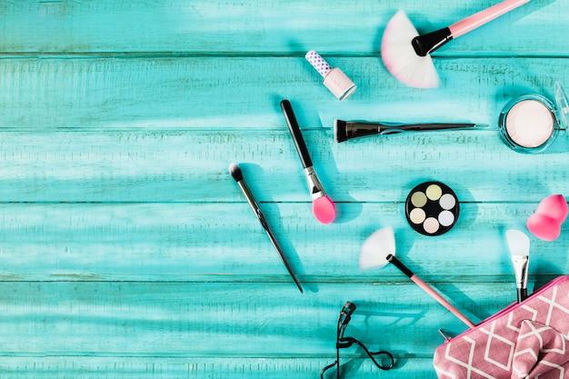 Applicators and cosmetics near makeup bag