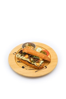 Applied korea and america hotdog breakfast style with breef pork cheese and vegetable on the circle wood plate