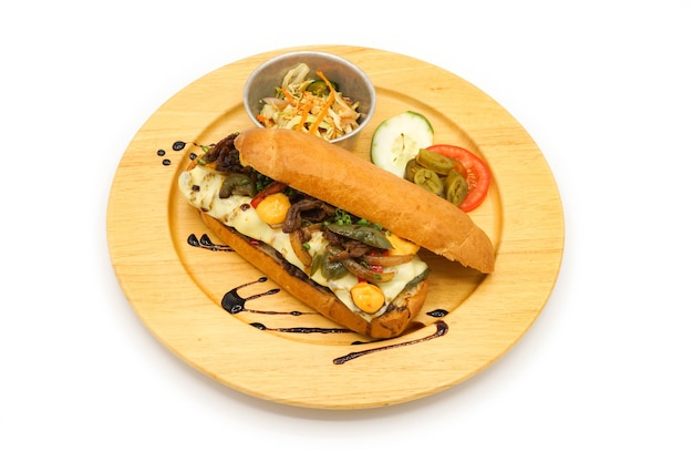 Applied korea and america hotdog breakfast style with breef pork cheese and vegetable on the circle wood plate.