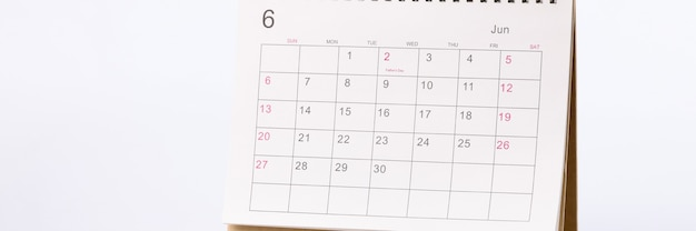 Applied paper calendar standing on white background
