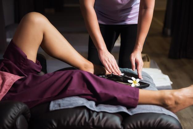 Apply lotion to legs. thai massage