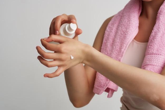 Applying cream on the skin moisturizing cosmetology
