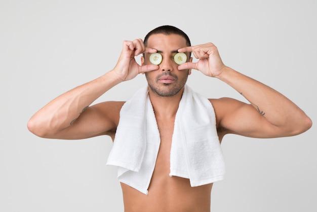 Applying cucumber eye mask