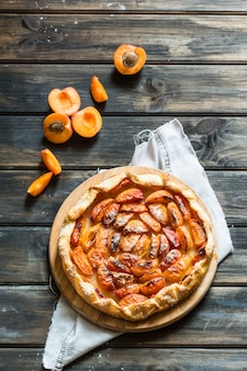 Apricot galette. process of baking. open pie, apricot tart. fruit bakery. ice cream with