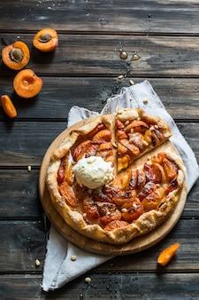 Apricot galette. process of baking. open pie, apricot tart. fruit bakery.