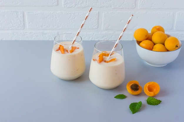 Apricot smoothie. fresh fruits with yogurt for healthy snack.