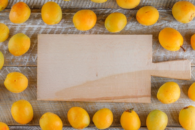 Apricots flat lay on wooden and cutting board