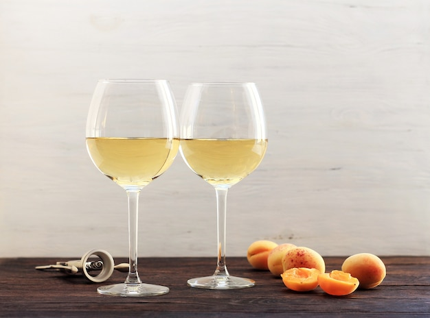 Apricots and two glasses of the white wine