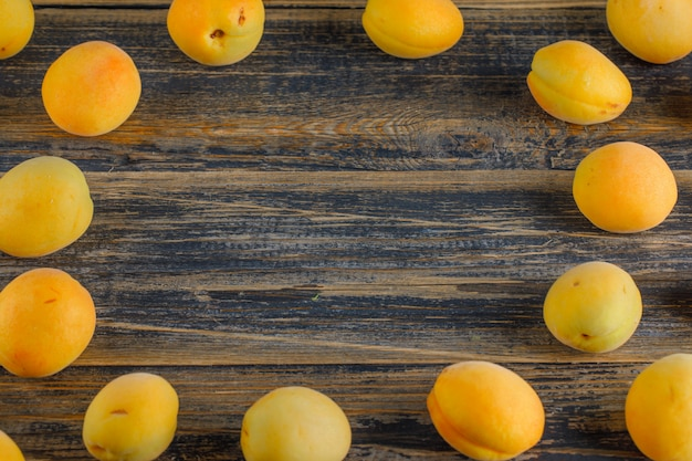 Apricots on a wooden table. top view.