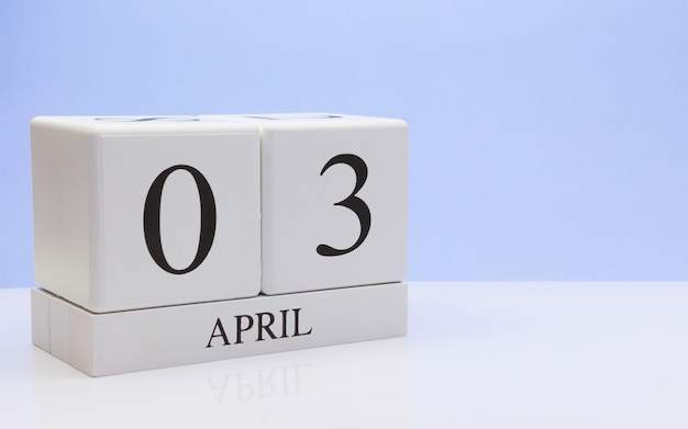 April 03st. day 03 of month, daily calendar on white table with reflection