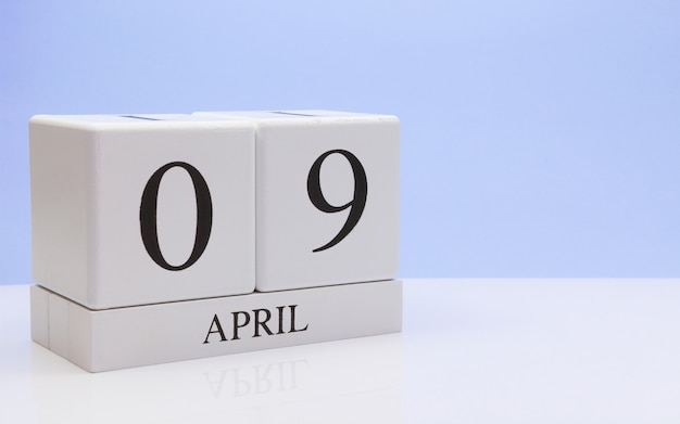 April 09st. day 09 of month, daily calendar on white table with reflection