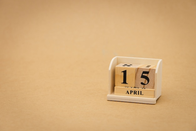 April 15 : wooden calendar on vintage wood abstract background. health day