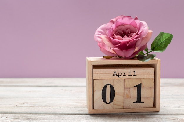 April 1st. image of april 1 wooden color calendar on wooden table. spring day