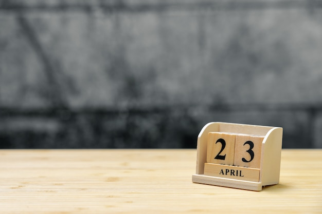 April 23 wooden calendar on vintage wood abstract background.