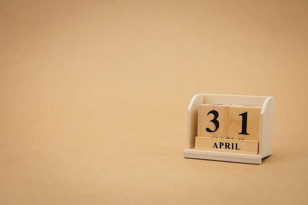 April 31 wooden calendar on vintage wood abstract background.