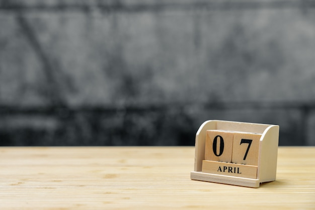 April 7 wooden calendar on vintage wood abstract background.