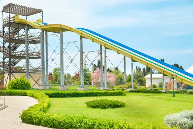 Aqua park constructions with big slides and pipe