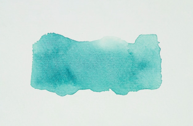 Aquamarine blot of paints on white paper