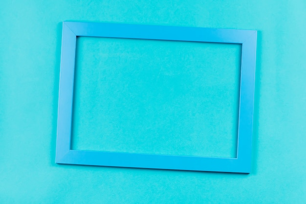 Aquamarine color frame on bright blue background.