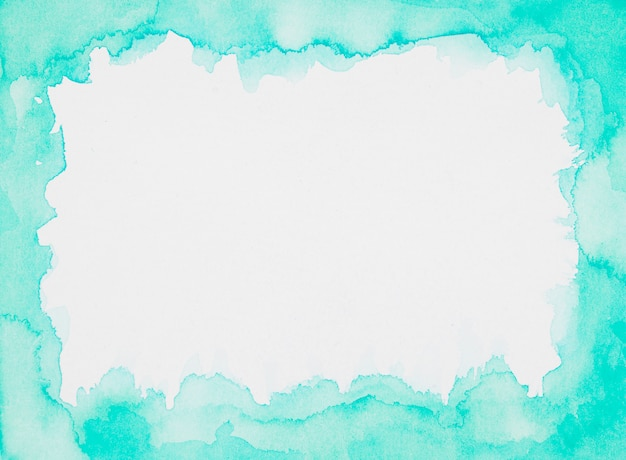 Aquamarine frame of paints on white sheet