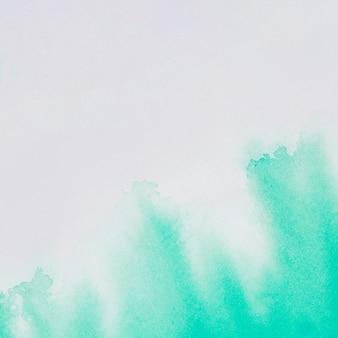 Aquamarine paints on white paper