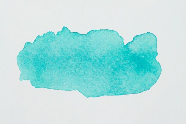 Aquamarine spot of paints on white paper